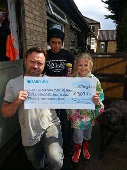 Wellingborough Homes presents cheque to Wellingborough Dog Welfare